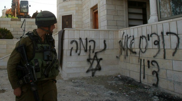 Israeli soldier walks past a mosque that was attacked by suspected Jewish extremists on the occupied West Bank. Read more: http://forward.com/articles/215446/west-bank-mosque-torched-by-price-tag-extremists-o/#ixzz3SnpxP5S8