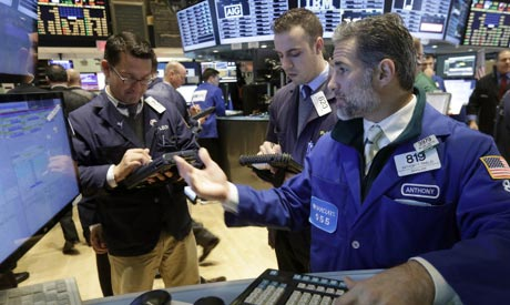 Specialist Anthony Rinaldi, right, works at his post on the floor of the New York Stock Exchange, Friday, Oct. 31, 2014 (Photo: AP)