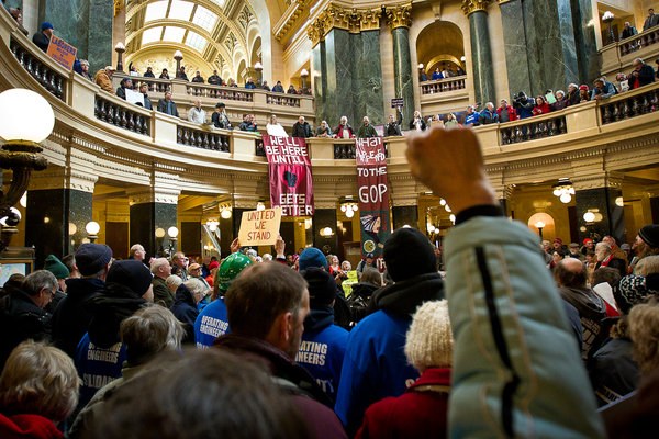 Union members and supporters at the Wisconsin State Capitol on Tuesday.   Credit Ben Brewer for The New York Times