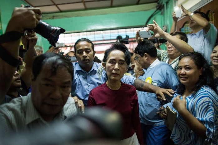 Opposition leader Aung San Suu Kyi arrives at a polling station to cast her vote during Burma's election. (Lam Yik Fei/Getty Images)