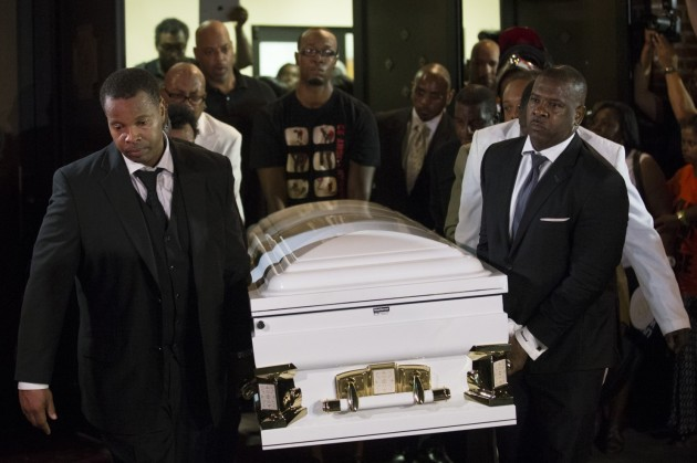 Pallbearers carry the casket of Eric Garner at Bethel Baptist Church following his funeral service, Wednesday, July 23, 2014, in the Brooklyn borough of New York. (John Minchillo/AP)