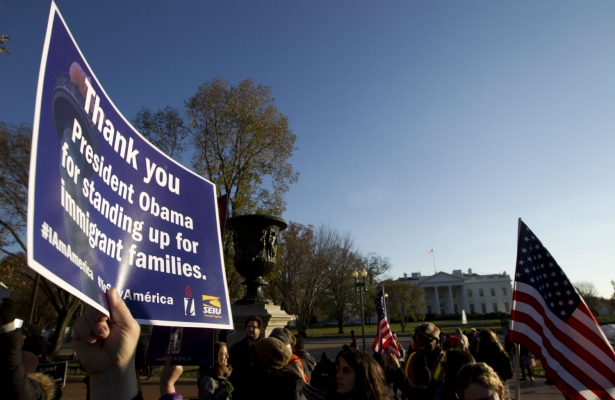 Supporters of immigration reform attend a rally in front of the White House in November 2014. (AP Photo/Jose Luis Magana)