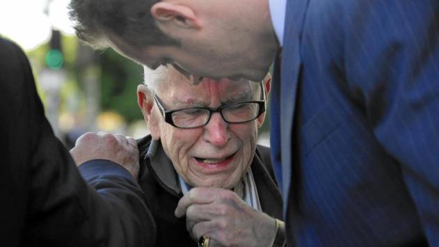 Brian Newt Beaird's father, Bill, weeps at a news conference in front of LAPD headquarters. The city paid $5 million to settle the family's lawsuit. (Irfan Khan, Los Angeles Times)