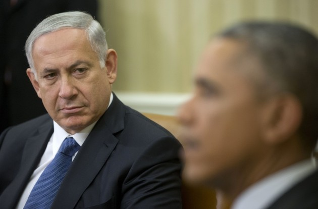 Israeli Prime Minister Benjamin Netanyahu listens as President Barack Obama speaks during their meeting in the Oval Office of the White House in Washington, Wednesday. (Pablo Martinez Monsivais/AP)