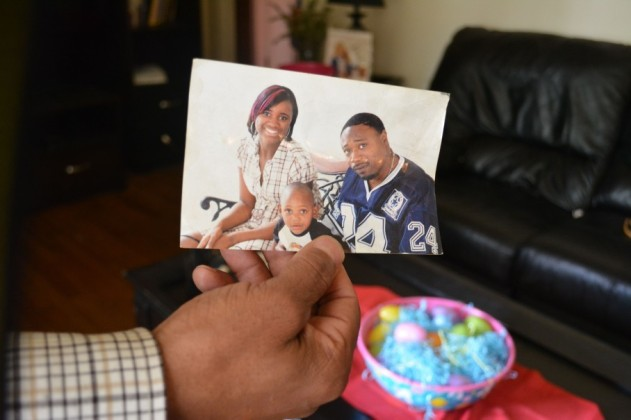Samuel Scott holds a photograph of Walter Scott (R), his cousin. (Christina Elmore/Post and Courier)