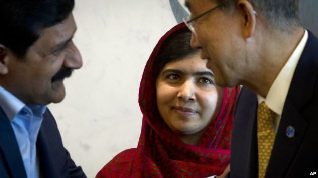 Pakistani schoolgirl activist Malala Yousafzai observes as her father, Ziauddin Yousafzai, meets U.N. Secretary General Ban Ki-moon at U.N. headquarters Aug. 18, 2014.