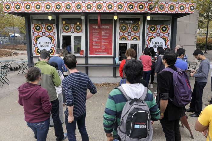 There were long lunch lines at the Conflict Kitchen in Schenley Plaza in Oakland for the first day of its Palestinian menu. Bob Donaldson/Post-Gazette