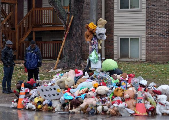 Two men look at a makeshift memorial on November 23 in Ferguson, Missouri, where Darren Wilson shot and killed Michael Brown Photo by JEWEL SAMAD/AFP/Getty Images