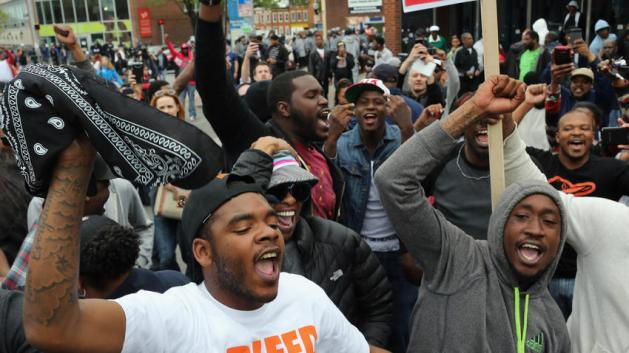 People celebrate after Baltimore authorities said there would be criminal charges against police in death of Freddie Gray. Win McNamee, Getty Images