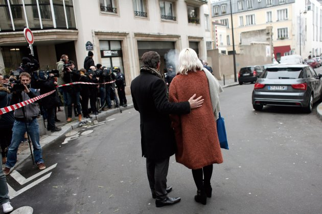"The mood among Parisians near the scene of the attack Wednesday on the newspaper Charlie Hebdo was apprehensive and angry. ""There's no respect for human life,"" said Annette Gerhard."