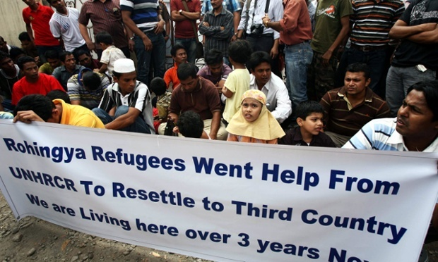 Rohingya refugees in Indonesia hold a banner during a protest outside the UNHCR office in North Sumatra in 2013. Photograph: Dedi Sahputra/EPA