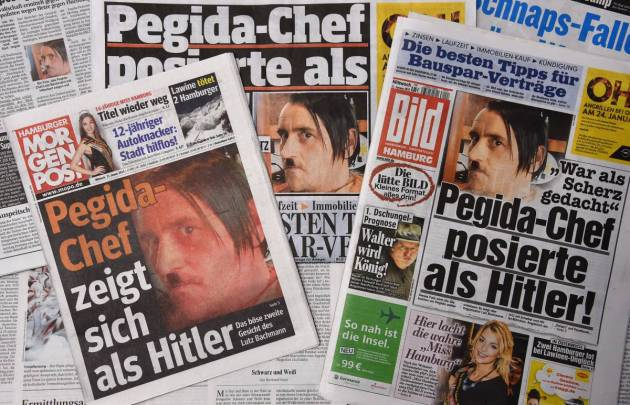 Front pages of German daily newspapers including Hamburger Morgenpost and Bild show pictures of the PEGIDA chief Lutz Bachmann sporting a Hitler moustache on Jan. 21 2015