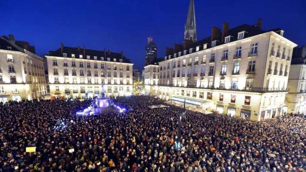 People gather at the Place Royale in Nantes, France, on Jan. 7 to show solidarity with the victims of the attack on the offices of the satirical weekly Charlie Hebdo. Georges Gobet / AFP/Getty Images
