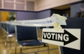 A voting sign directing voters is seen before polls open at the Grove Presbyterian Church in Charlotte, North Carolina, November 4, 2014. (Reuters/Chris Keane)