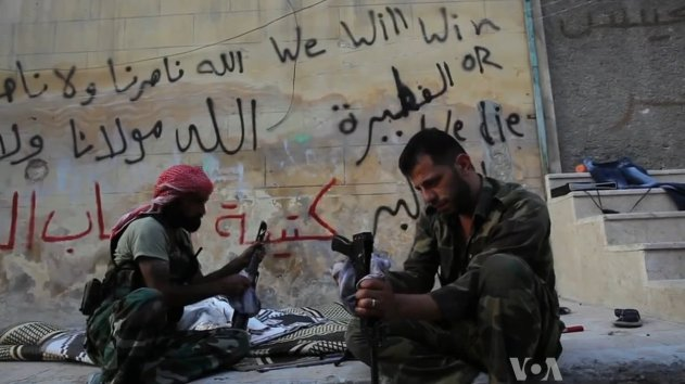 FSA rebels cleaning their AK47s in Aleppo, Syria during the civil war (19 October 2012).