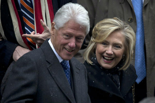 Former President Bill Clinton and former Secretary of State Hillary Clinton depart the former Governor of New York Mario Cuomo's funeral in Manhattan, N.Y., on Jan. 6. A new poll suggests that Ms. Clinton's stint as first lady could be a plus for her potential presidential bid.