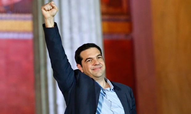 Alexis Tsipras raises his fist to supporters after winning the elections. Photograph: Giorgos Moutafis/Reuters
