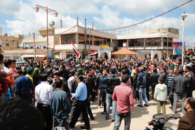 """Syrians shout """"freedom"""" during a protest near the city of Deraa."""