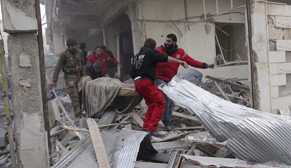 Red Crescent members and residents remove a body from a damaged site after what activists said were airstrikes by forces loyal to Syria's President Bashar al-Assad in Douma, eastern Ghouta, near Damascus, Jan. 25, 2015. (photo by REUTERS/Badra Mamet) Read more: http://www.al-monitor.com/pulse/originals/2015/01/syria-jaish-al-islam-damascus-rockets-army-ghouta.html#ixzz3QNWnXLz3