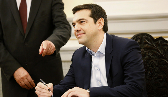 Alexis Tsipras, Syriza party leader and winner of the Greek parliamentary elections, signs papers appointing him as Greece's first leftist prime minister after his swearing-in ceremony at the presidential palace in Athens, Jan. 26, 2015. (photo by REUTERS/Yannis Behrakis) Read more: http://www.al-monitor.com/pulse/originals/2015/01/turkey-greece-syriza-victory-kurds.html##ixzz3QSxgF3kJ