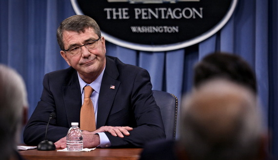 U.S. Secretary of Defense Ashton Carter and Chairman of the Joint Chiefs General Martin Dempsey (not pictured) speak to reporters at the Pentagon in Washington April 16, 2015. REUTERS/James Lawler Duggan - RTR4XNHW