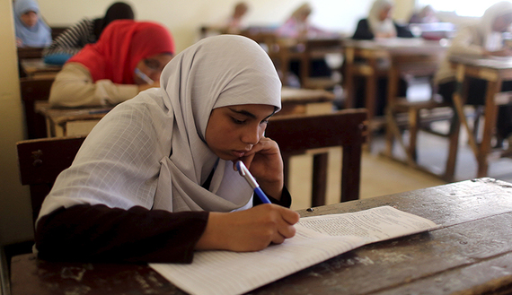 Students take an exam in one of the Al-Azhar institutes in Cairo, Egypt, May 20, 2015. Picture taken May 20, 2015. To match Special Report EGYPT-ISLAM/AZHAR    REUTERS/Asmaa Waguih  - RTR4Y73S