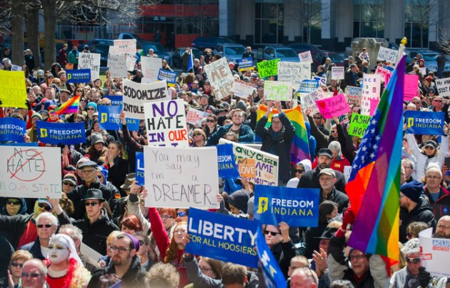Thousands gathered outside the Indiana Statehouse on Saturday to protest a law that opponents say allows for bias against gays.  Credit Doug McSchooler/Associated Press