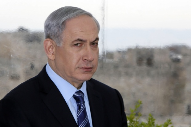 Prime Minister Netanyahu looks on during a press conference with Jerusalem mayor Nir Barkat (AFP)