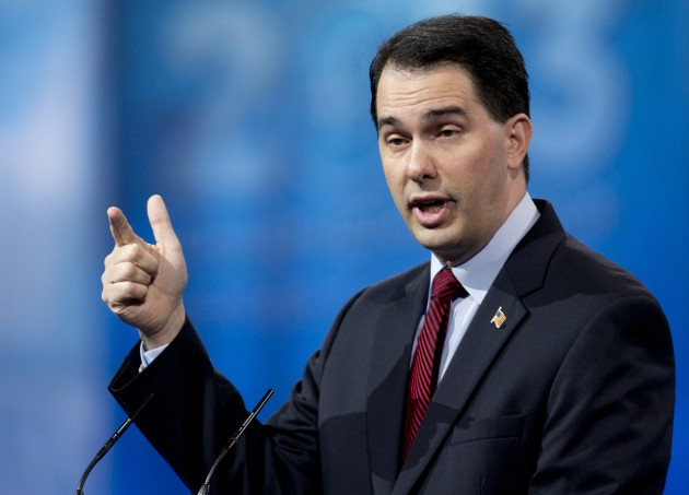 Wisconsin Gov. Scott Walker gestures as he speaks at the 40th annual Conservative Political Action Conference in National Harbor, Md., Saturday, March 16, 2013. (AP Photo/Carolyn Kaster)