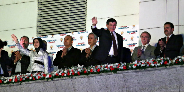 Prime Minister Ahmet Davutoğlu (3rd R) waves to supporters from the balcony of the AK Party headquarters in Ankara on June 7. (Photo: DHA)