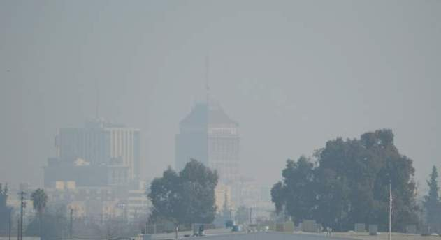 The downtown Fresno skyline with heavy haze is seen, Jan. 17, 2014.