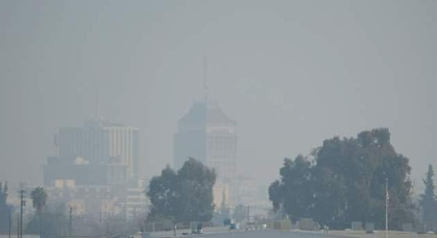 The downtown Fresno skyline with heavy haze is seen, Jan. 17, 2014.