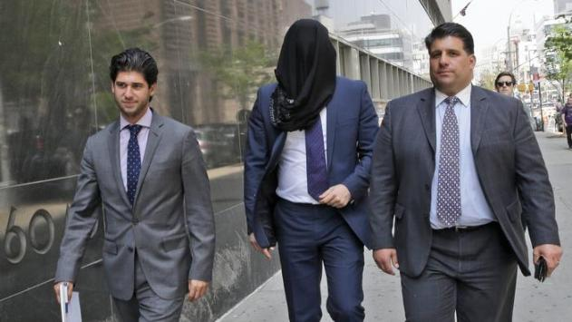 Wojciech Braszczok is led into the court with his face covered Tuesday in New York. (Mary Altaffer / Associated Press)