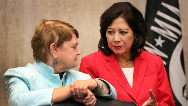 L.A. County Supervisor Sheila Kuehl, left, talks to Supervisor Hilda L. Solis on Tuesday. Both supervisors voted to welcome Syrian refugees. (Al Seib / Los Angeles Times)