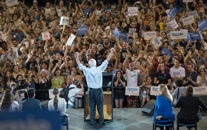 Democratic presidential candidate Senator Bernie Sanders lifts his arms in celebration as he speaks at a rally on August 9, 2015, in Portland. (AP Photo/Troy Wayrynen)