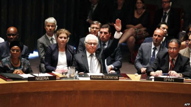 Vitaly Churkin, Russia's ambassador to the United Nations, votes to veto on a draft resolution for establishing a tribunal to prosecute those responsible for downing the MH17 flight during a UN Security Council meeting in New York in July.