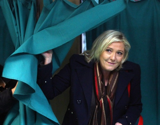 Marine Le Pen, leader of the French far-right National Front party, exits a polling booth during the second round of regional elections in Henin-Beaumont, northern France. (Michel Spingler/AP)
