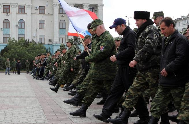 Russian soldiers and pro-Russian volunteers during a military parade rehearsal in preparation for the Victory Day parade in Simferopol, Crimea, on April 12, 2014. (AFP/Yuri Lashov)