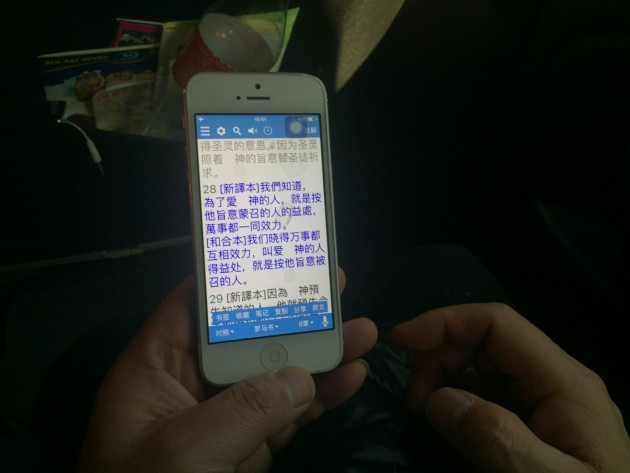 Pastor Su Tianfu, a Protestant preacher from Guiyang, China, reads the Bible on his iPhone. His church was recently shuttered in a sweeping government crackdown. (Emily Rauhala/The Post)
