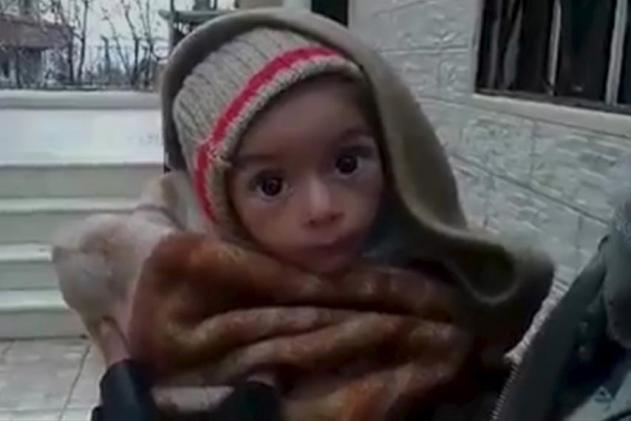 A toddler is held up to the camera in this still image taken from video said to be shot in Madaya on January 5, 2016. Handout via Social Media Website / Reuters
