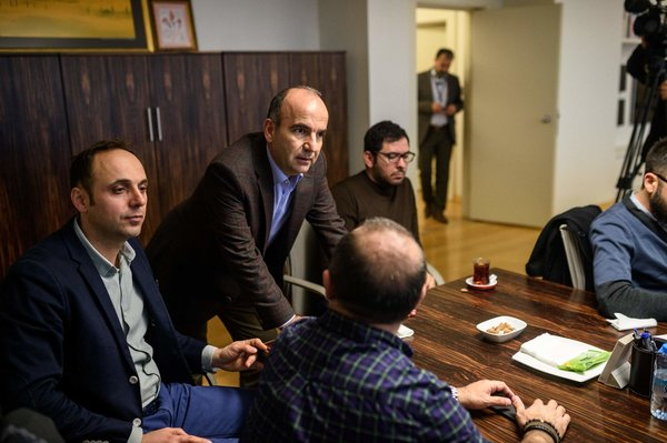 Zaman's editor in chief, Abdulhamit Bilici, second from left, on Friday with journalists who came to offer support.  Credit Ozan Kose/Agence France-Presse — Getty Images