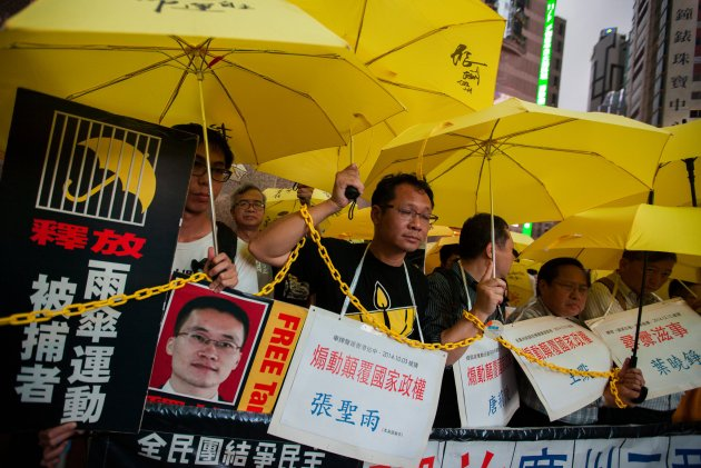 People last year protesting the detention of Chinese activists who support Hong Kong's Umbrella Movement, including Lu Gengsong and Chen Shuqing, in Hong Kong. Alex Hofford/European Pressphoto Agency