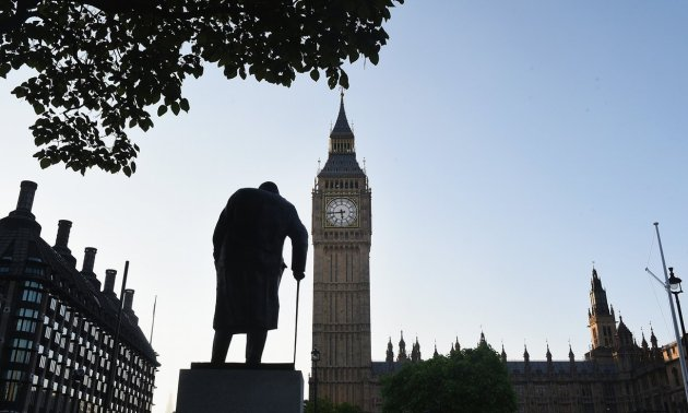 The sun rises over the the statue of Winston Churchill and the Houses of Parliament as votes are counted. Photograph: Mary Turner/Getty Images