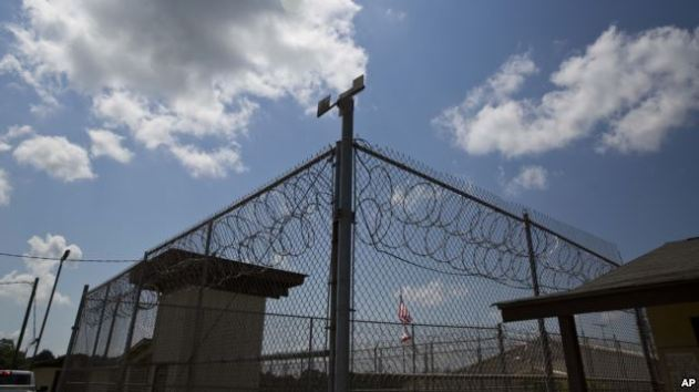 FILE - In this 2015 photo, a fence stands at Elmore Correctional Facility in Elmore, Ala.
