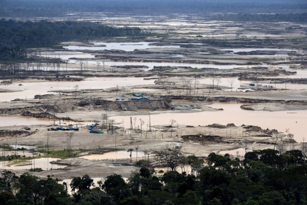 Aerial view taken from a police helicopter shows a jungle devastated by gold mining in an area known as La Pampa in Peru's Madre de Dios region. Illegal wildcat mining has been ravaging pristine jungle and contaminating it with tons of mercury.