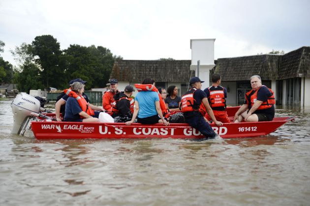 Coast Guardsmen rescue stranded residents from high water during severe flooding around Baton Rouge, La., Aug. 14, 2016. Coast Guard photo by Petty Officer 3rd Class Brandon Giles