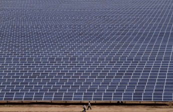 A utility-scale solar plant in India. CREDIT: AP PHOTO/AJIT SOLANKI