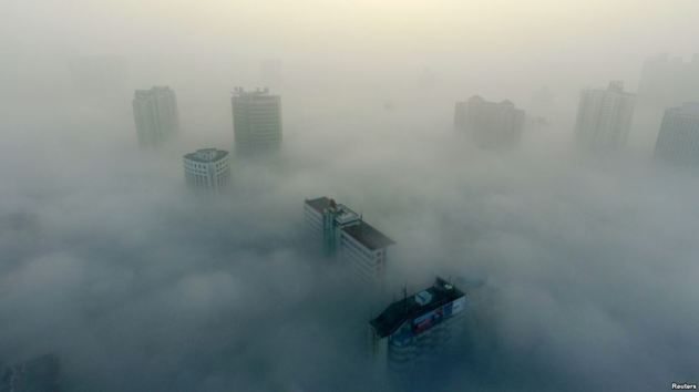 Buildings are seen on a hazy day in Xiangyang, Hubei province, China, Dec. 31, 2016. The current round of air pollution struck Friday and isn't expected to lift until Thursday.