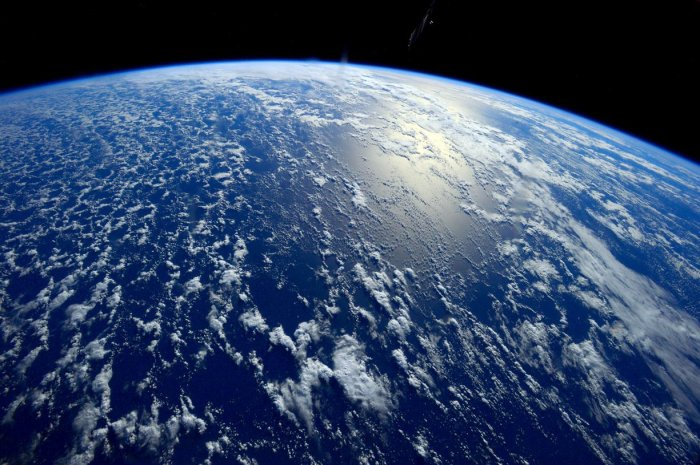 Greenhouse gas emissions caused by humans over the past 45 years have increased the rate of temperature rise to 1.7 degrees celsius per century. Photograph: ISS/NASA[/caption]